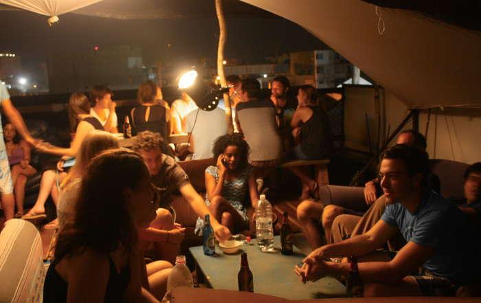 overstay tel aviv hostel rooftop bar action