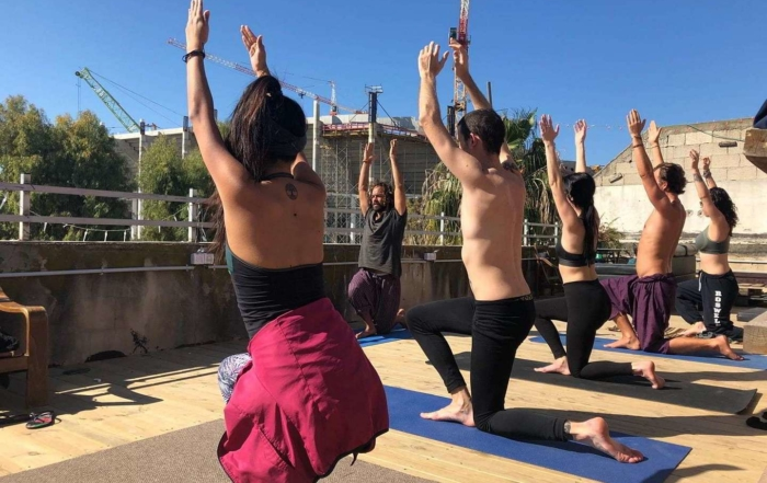 yoga lesson at overstay jaffa hostel